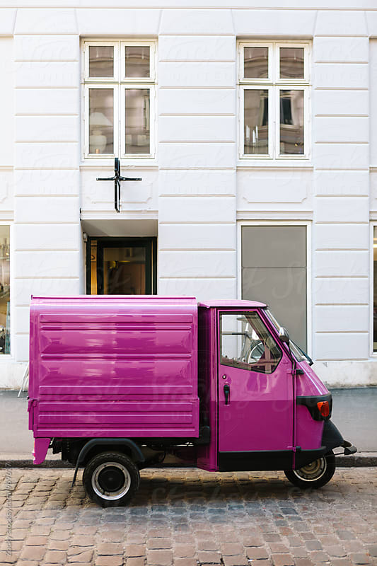 Pink three-wheeled light commercial vehicle by Zocky for Stocksy United