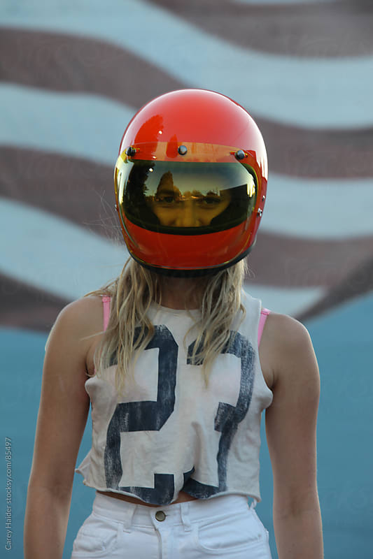 Woman Standing In A Motorcycle Helmet by Carey Haider for Stocksy United
