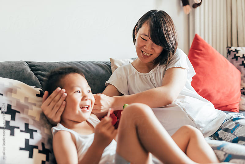 A pregnant mother and her 3 year old son at home by MaaHoo Studio for Stocksy United