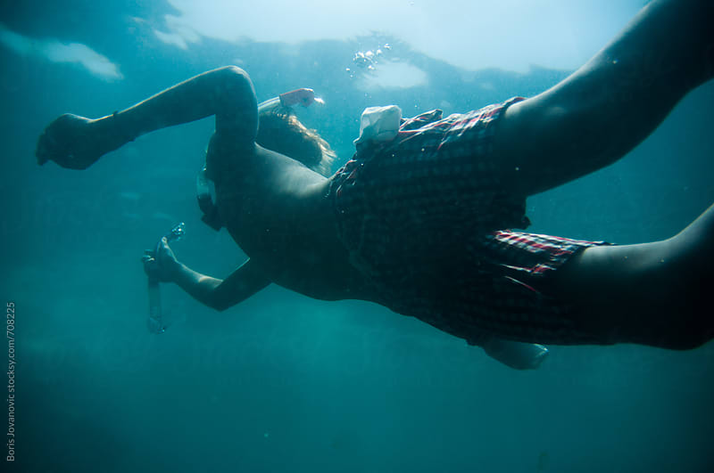 Young diver diving in the open sea by Boris Jovanovic for Stocksy United