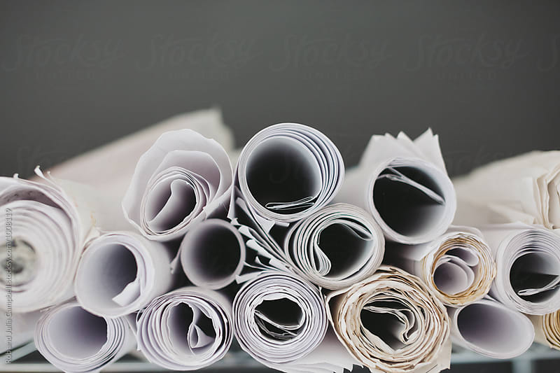 Rolls of paper plans by Rob and Julia Campbell for Stocksy United