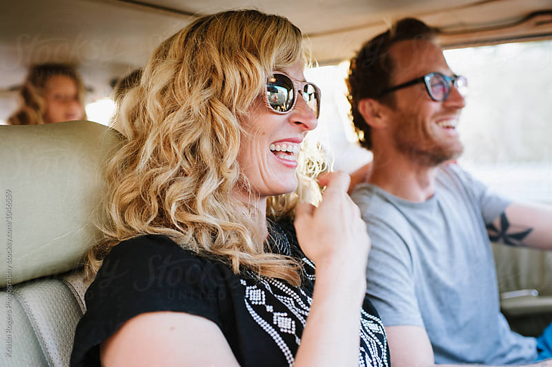Couple driving in car smiling by Kristin Rogers Photography for Stocksy United