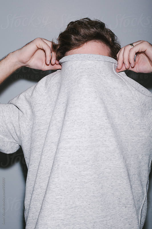 Man Hides Behind Sweater by Caleb Thal for Stocksy United