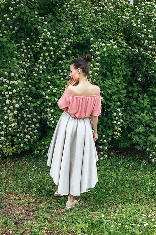 Portrait of a female model in beautiful skirt from back by Branislava Živić for Stocksy United
