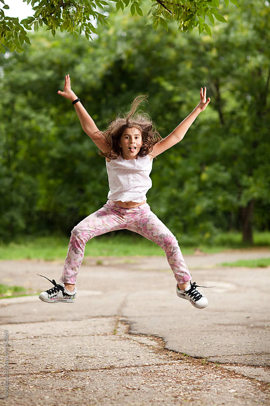 Girl jumping. by Mosuno for Stocksy United