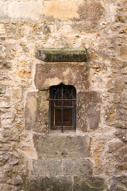Window of a building in a medieval town by Marilar Irastorza for Stocksy United