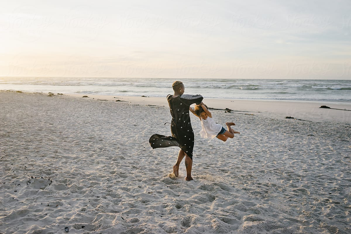 Swinging On The Beach by Bruce And Rebecca Meissner