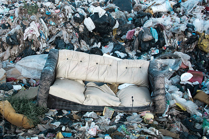 Old sofa at landfill by Per Swantesson for Stocksy United