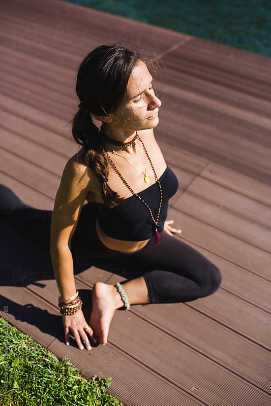 Doing yoga: Half Pigeon Pose  by michela ravasio for Stocksy United