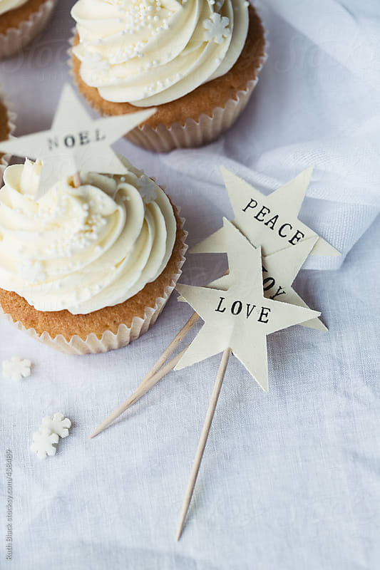 Christmas cupcakes with hand crafted cake picks by Ruth Black for Stocksy United