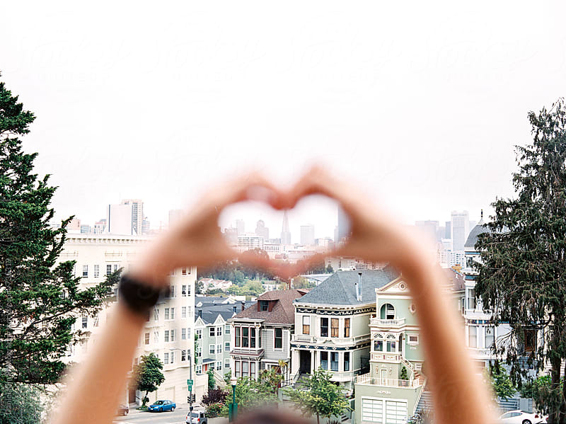Heart hands over San Francisco by Daniel Kim Photography for Stocksy United