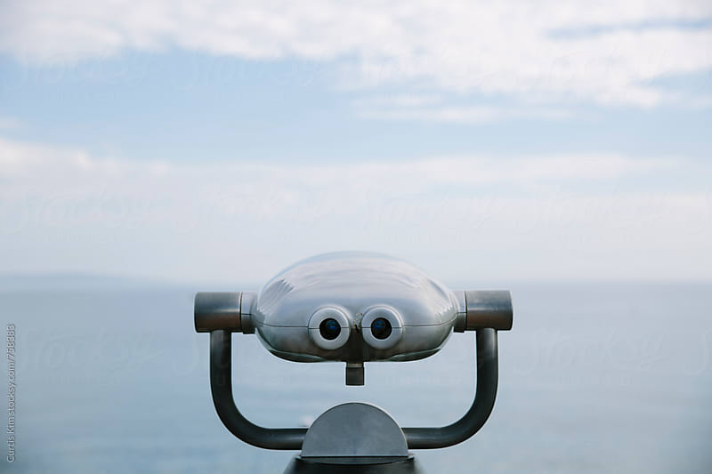 Binoculars overlooking the ocean by Curtis Kim for Stocksy United