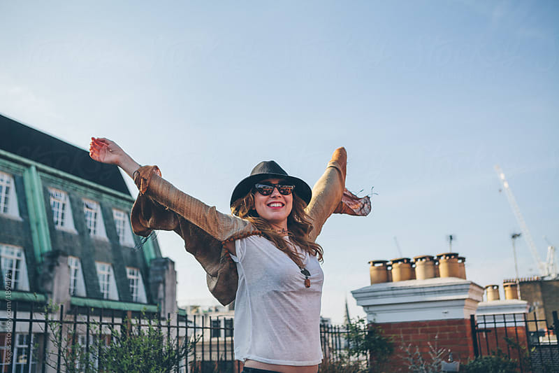 Blonde woman on a roof in London by kkgas for Stocksy United