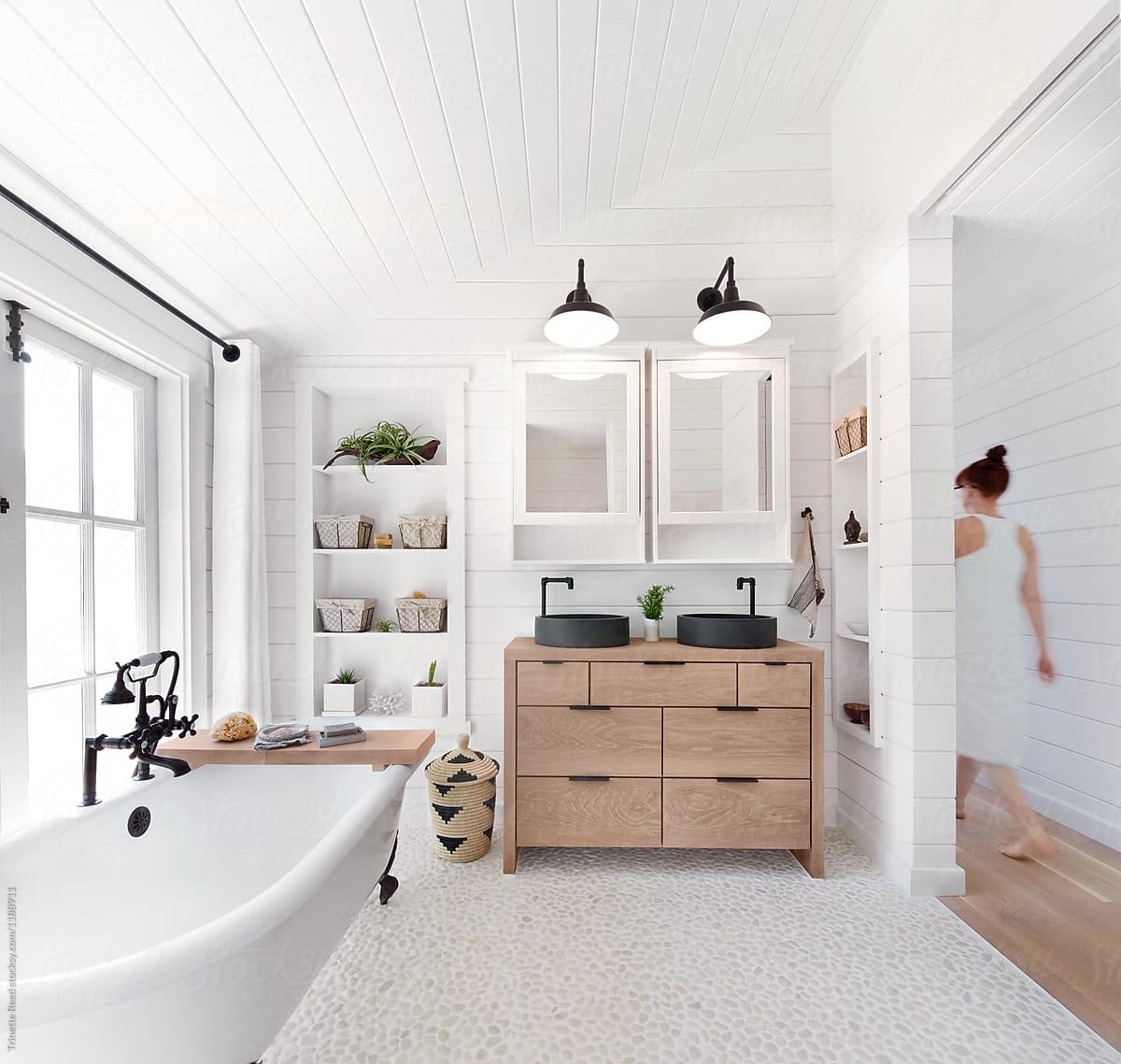 Modern Farmhouse Bathroom: Woman Walking Down Hallway In Rustic Modern Farmhouse