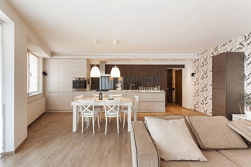 Modern kitchen interior with sofa in front  by Borislav Zhuykov for Stocksy United