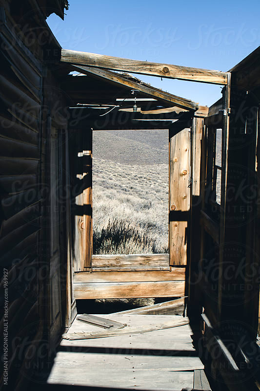 Shadows on Porch of Creepy Ghost Town Home by MEGHAN PINSONNEAULT for Stocksy United