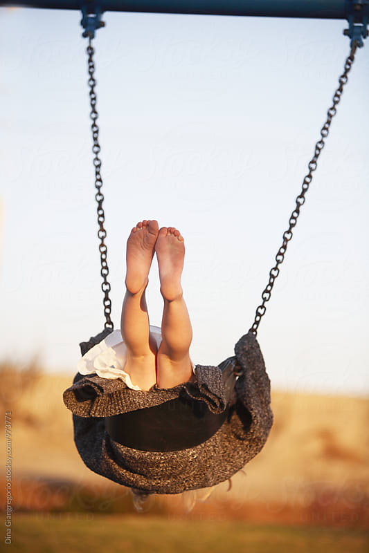 Feet and Leg View Of Girl Swinging Upwards by Dina Giangregorio for Stocksy United
