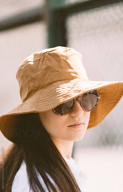 summer portrait of young woman with hat by Vesna for Stocksy United
