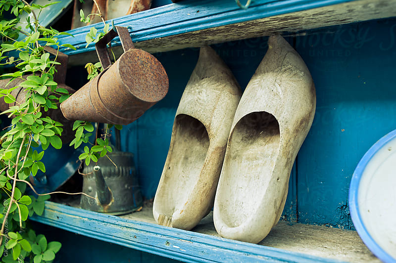 Typical Dutch Clogs Leaning on the Ledge by GIC for Stocksy United