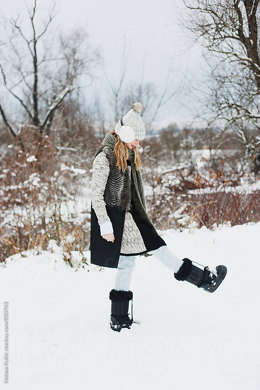 Young beautiful woman in the snow by Natasa Kukic for Stocksy United
