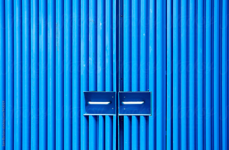 Blue doors by Sam Burton for Stocksy United