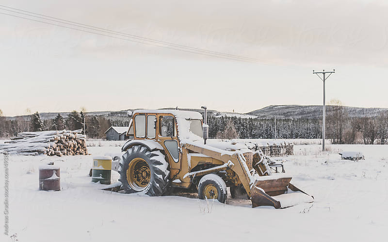 winter tractor by Andreas Gradin for Stocksy United