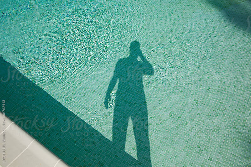 Shadow projected on a pool by CACTUS Blai Baules for Stocksy United