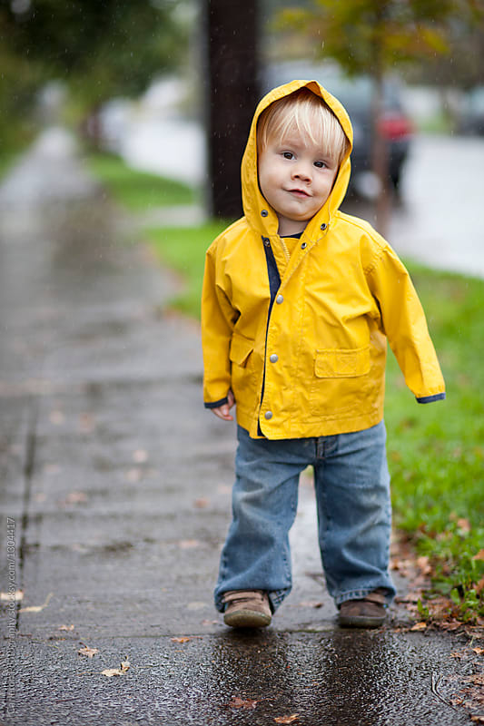 19-month-old boy in yellow rain jacket on a rainy day in Portland, Oregon