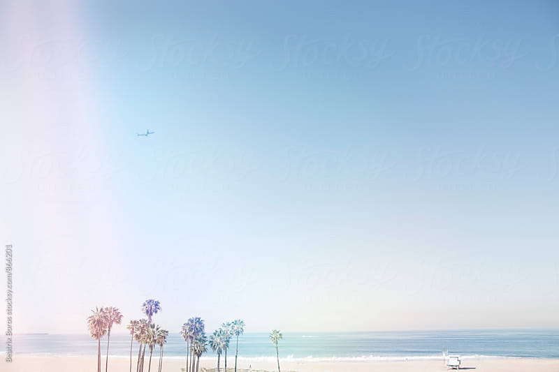 Double exposure of Californian beach and colorful light reflections by Beatrix Boros for Stocksy United