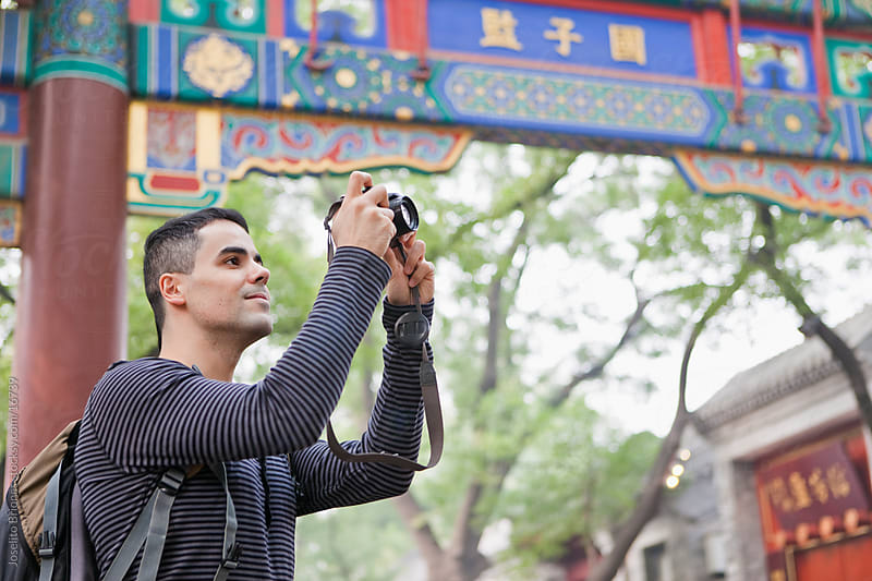 Tourist Taking Photos with Digital Camera on Holiday in Beijing, China by Joselito Briones for Stocksy United