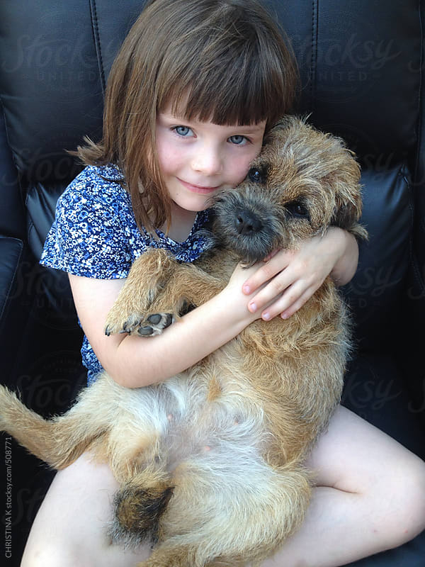 Little girl hugging her dog by CHRISTINA K for Stocksy United
