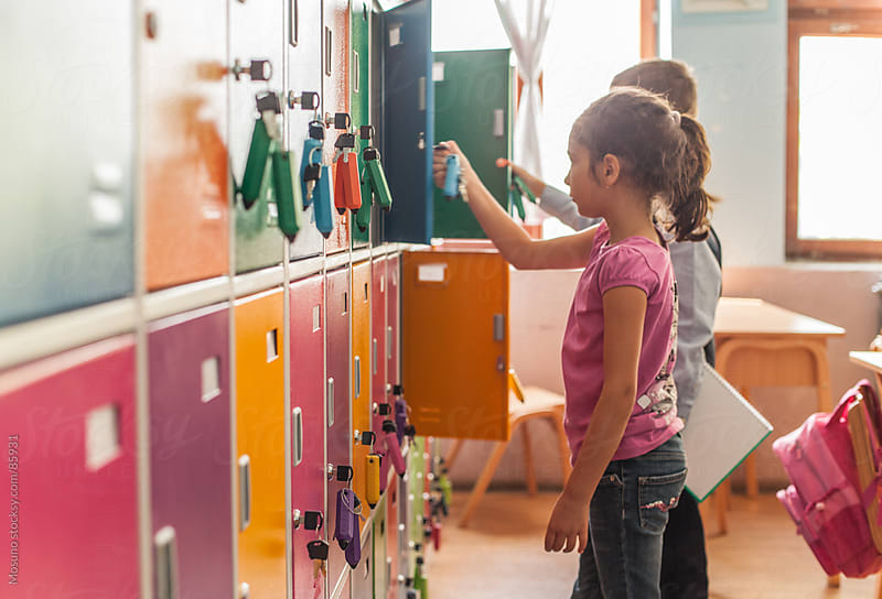 Schoolchildren Next to Their Lockers by Mosuno for Stocksy United
