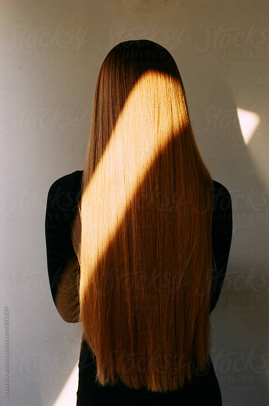 Back view of a woman with long hair by Lyuba Burakova for Stocksy United