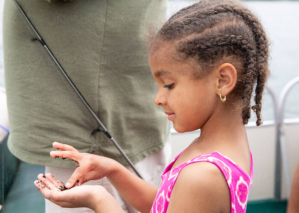 Super Cute Young Girl With Cornrow Braids Examining The Bait Worms While Schematic Wiring Diagrams Amerangerunnerswayorg