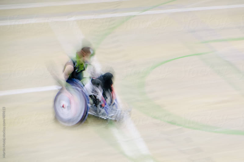 Blurry shot of wheelchair man by Martin Matej for Stocksy United