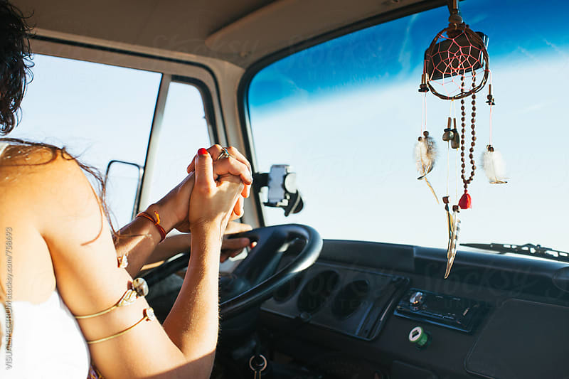 Road Tripping - Couple Holding Hands Inside Camper Van on Sunny Day by Julien L. Balmer for Stocksy United
