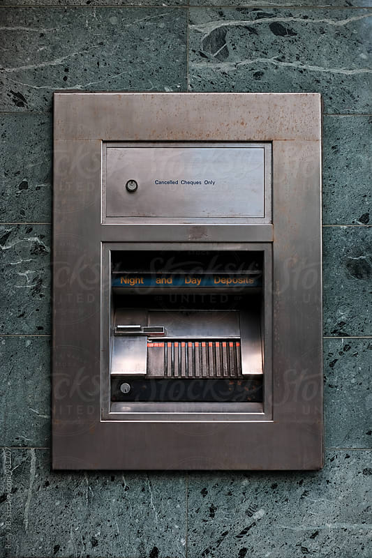 A deposit drawer on the exterior of a bank by Riley J.B. for Stocksy United