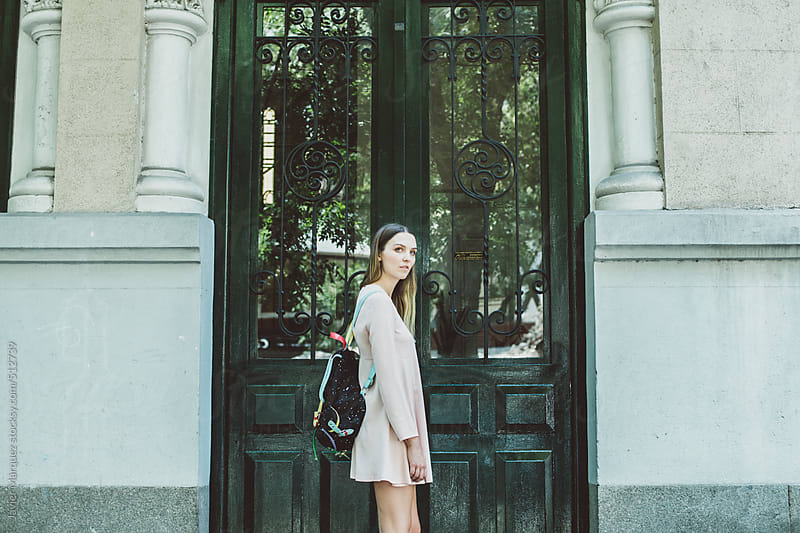 Young Woman in the Street by Javier Márquez for Stocksy United