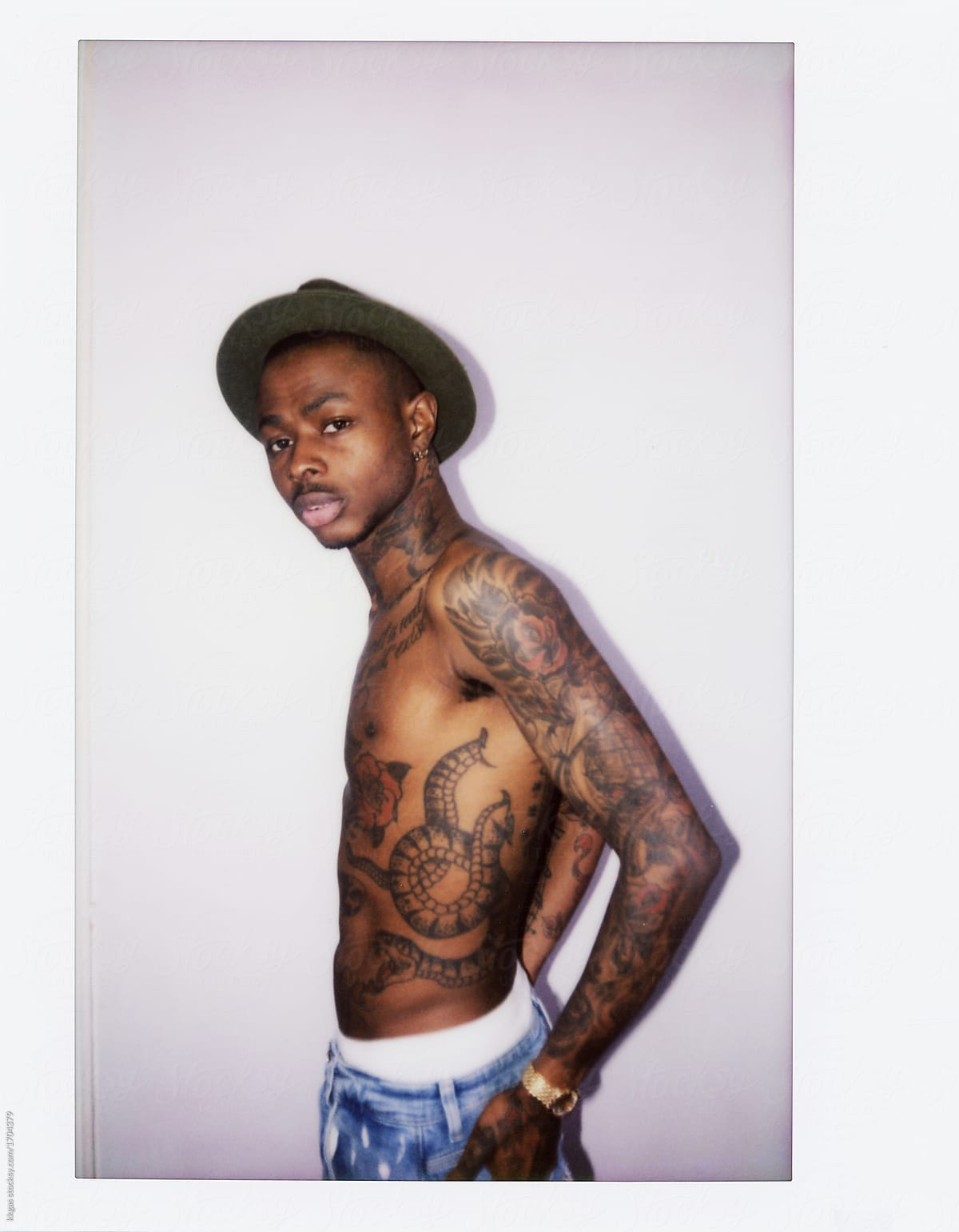 a4a4ff2f53c65 Instant print of a cool tattooed black guy with Fedora hat. by kkgas for  Stocksy