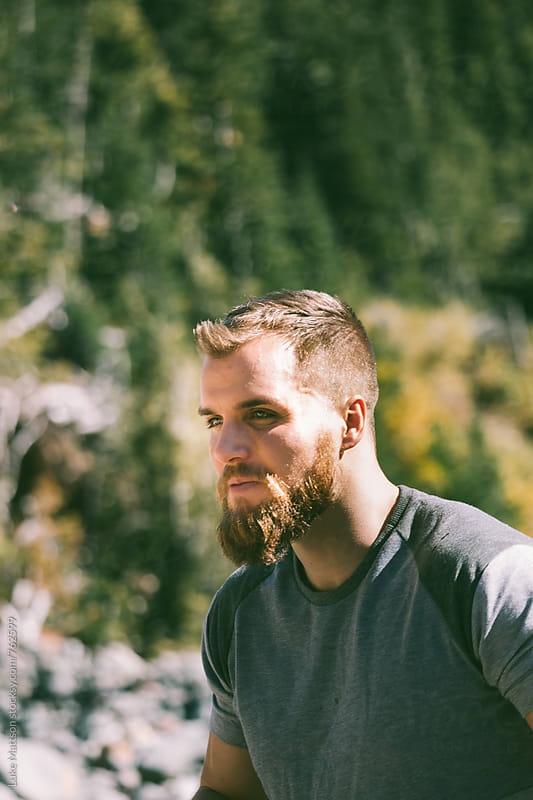 Stoic Bearded Blond Man On Forest Hike by Luke Mattson for Stocksy United