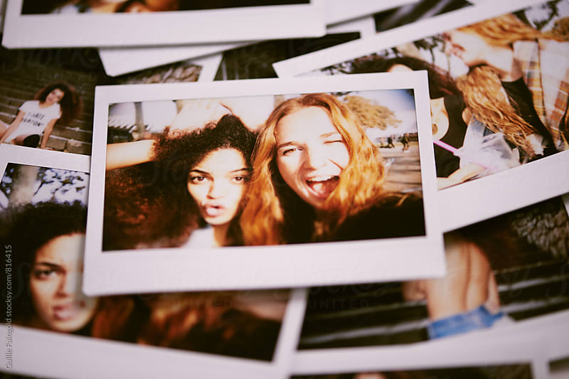 Heap of instant photos of best friends by Guille Faingold for Stocksy United