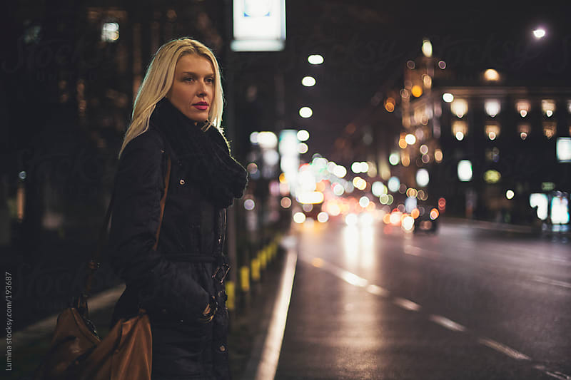 Woman on the Street at Night by Lumina for Stocksy United