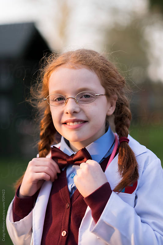 Little girl with pigtails dressed as a doctor. by Craig Holmes for Stocksy United