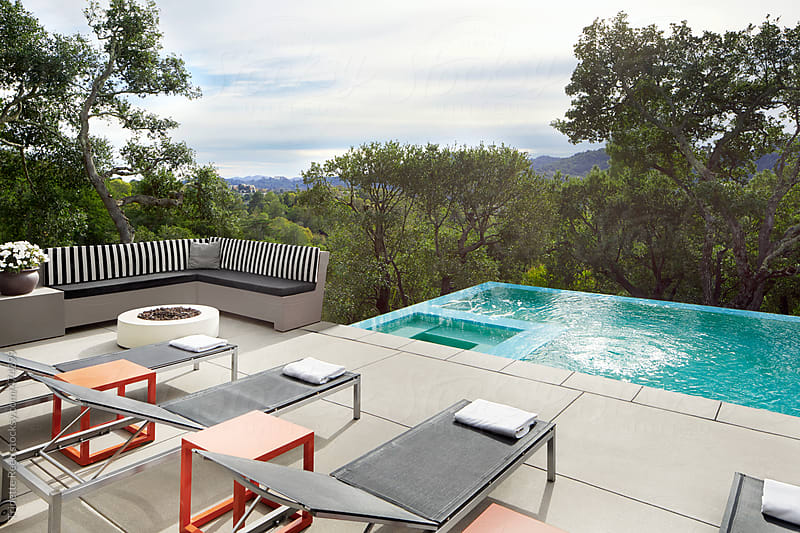 Beautiful luxury home with backyard swimming pool by Trinette Reed for Stocksy United
