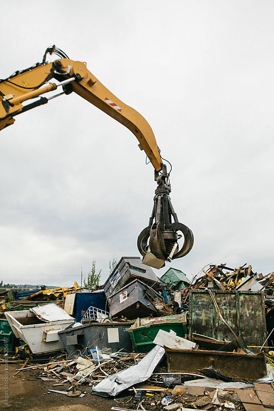 Excavator sorting out metal for recycling at a recycling centre by kkgas for Stocksy United