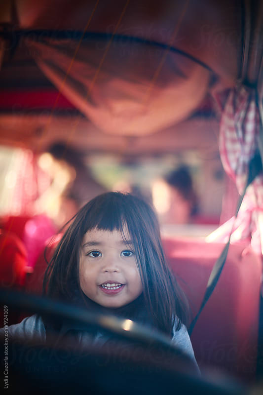 Portrait of a beautiful little girl in a camper van by Lydia Cazorla for Stocksy United