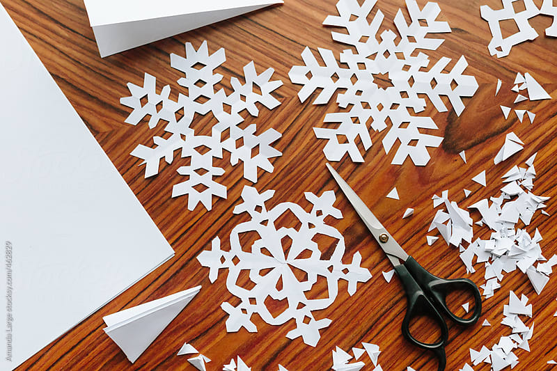 Making paper snowflake crafts. by Amanda Large for Stocksy United