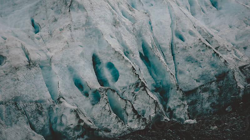Glacier cracks by Jeff Marsh for Stocksy United