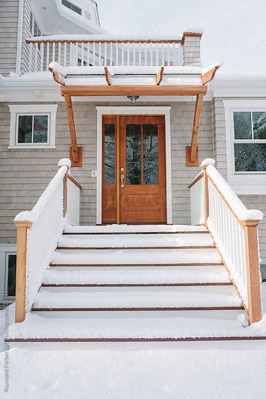 Front Door of Home after winter Storm by Raymond Forbes LLC for Stocksy United