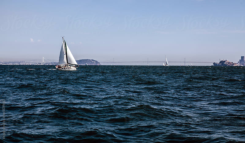 Sailing boat in San Francisco Bay, San Francisco Bay Bridge on the backgoround by kkgas for Stocksy United